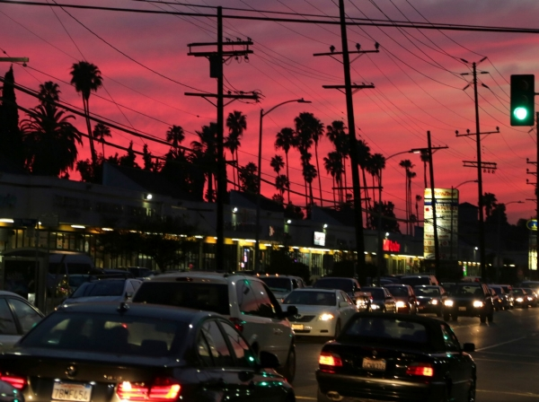 "Traffic moves on Santa Monica Boulevard in Hollywood, one of several neighborhoods designated by the Obama administration as a ""Promise Zone"" in Los Angeles, California, January 23, 2014"