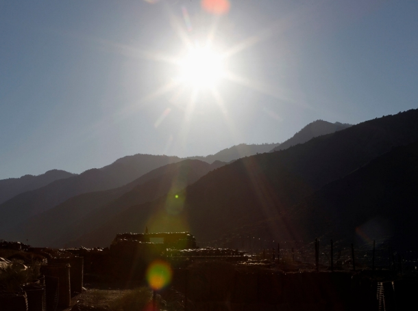 The sun rises above the mountain ridges of Kunar province overlooking the bunkers of soldiers from the Afghan army at Combat Outpost Pirtle King in Ghaziabad district in eastern Afghanistan, September 24, 2011, photo by Erik De Castro/Reuters