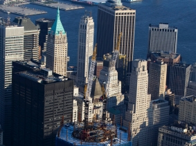 The under-construction One World Trade Center stands over New York's Manhattan skyline on August 24, 2011, photo by Lucas Jackson/Reuters