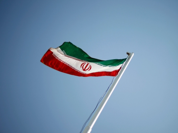 An Iranian flag flutters during the opening ceremony of the 16th International Oil, Gas & Petrochemical Exhibition in Tehran, April 15, 2011, photo by Morteza Nikoubazl/Reuters
