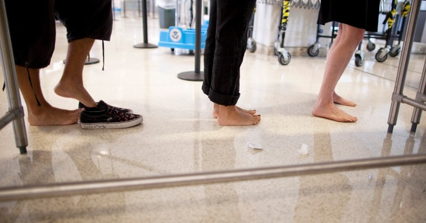 Fliers take off their shoes before going through a TSA security checkpoint in the Newark Liberty International Airport in Newark, New Jersey, July 28, 2011, photo by Lucas Jackson/Reuters