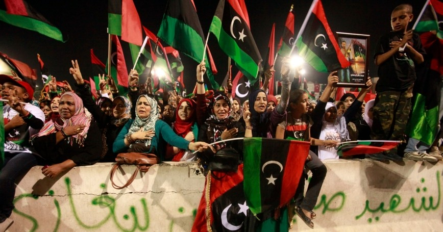 People celebrate the death of Muammar Gaddafi at Martyrs' Square in Tripoli, Libya, October 20, 2011, photo by Suhaib Salem/Reuters