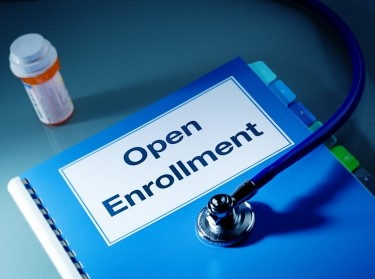 Affordable Care Act Open Enrollment binder and stethoscope, photo by YinYang/Getty Images