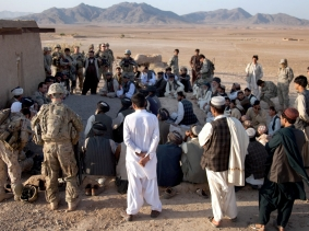 U.S. soldiers and Afghan police officers talk with Afghan citizens at Checkpoint 64 near Loy Karez in Kandahar province, Afghanistan, November 2, 2011, photo by Spc. Louis Kernisan/U.S. Army