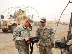 Army Sgt. Brian McCown teaches Army Pfc. Frankie Busby the responsibilities of an electronic warfare noncommissioned officer at Camp Taji, Iraq, June 9, 2011, photo by Spc. William A. Joeckel/U.S. Army