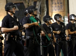 LAPD officers stand guard during celebrations after the Los Angeles Lakers defeated the Boston Celtics in Game 7 of the 2010 NBA Finals basketball series in Los Angeles June 17, 2010, photo by Mario Anzuoni/Reuters