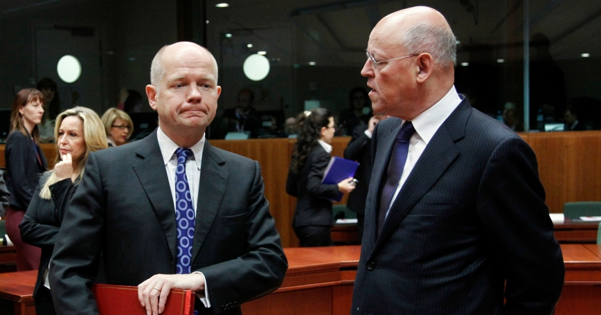 Britain's Foreign Secretary William Hague (L) talks to Dutch Foreign Minister Uri Rosenthal at the start of a European Union foreign ministers meeting at the EU Council headquarters in Brussels, December 1, 2011
