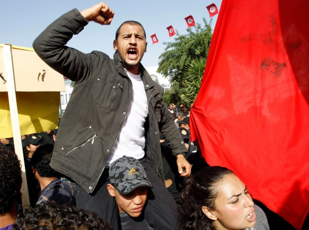 A protester shouts during a demonstration outside the parliamentary building in Tunis, Tunisia, November 22, 2011, photo by Zoubeir Souissi/Reuters