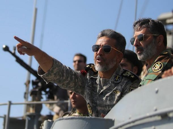 Iran's Navy commander Habibollah Sayyari points from a naval ship during Velayat-90 war game on Sea of Oman near the Strait of Hormuz, Iran, January 1, 2012
