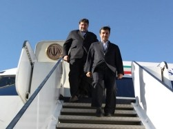 Iranian President Mahmoud Ahmadinejad exits a plane as he arrives in Kerman province, southeast of Iran, January 26, 2012