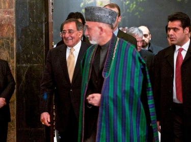 Defense Secretary Leon E. Panetta enters a press conference with Afghan President Hamid Karzai in Kabul, Afghanistan, December 14, 2011, photo by Erin A. Kirk-Cuomo/U.S. Dept. of Defense