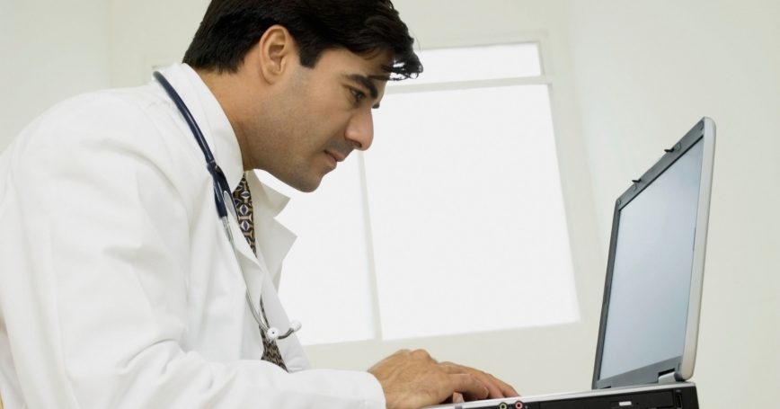 A doctor using a laptop