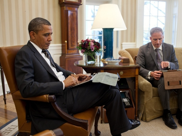 President Barack Obama receives the Presidential Daily Briefing from Robert Cardillo, Deputy Director of National Intelligence for Intelligence Integration, in the Oval Office, Jan. 31, 2012