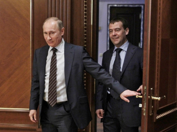 Russian President Dmitry Medvedev (R) and Prime Minister Vladimir Putin arrive at a meeting on taxation issues at the Gorki presidential residence outside Moscow, March 6, 2012