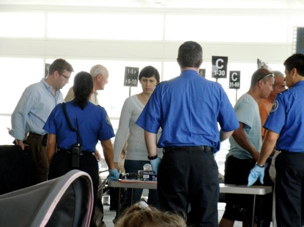 Passengers shuffling through an airport