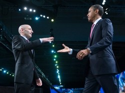 U.S. President Barack Obama (R) shakes hands with American Israel Public Affairs Committee President Lee Rosenberg before he delivers remarks to AIPAC's annual policy conference in Washington, March 4, 2012