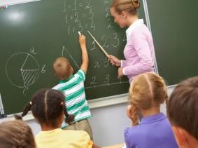 Teacher helping student with math problem