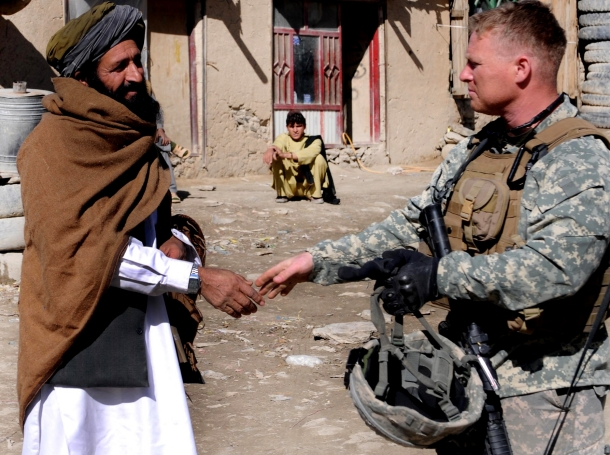 U.S. Army Major greets a local resident at Jani Kheyl, Afghanistan