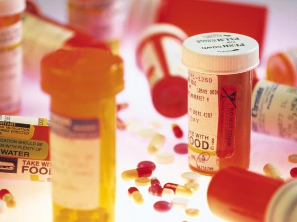 Various prescription bottles and pills