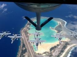 A KC-135 Stratotanker prepares to refuel Navy F/A-18 Hornets