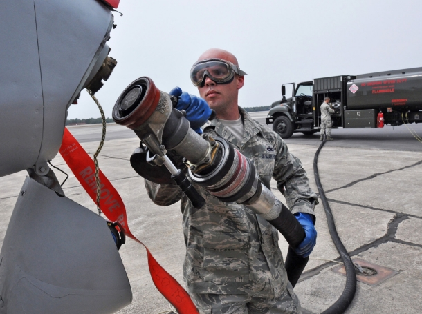 A soldier fuels an A-10C Thunderbolt II for the first flight of an aircraft powered solely by a biomass-derived jet fuel blend