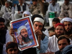 Supporters of Pakistani religious party Jamiat-e-Ulema-e-Islam hold an image of al-Qaeda leader Osama bin Laden during an anti-American rally in Quetta May 2, 2012