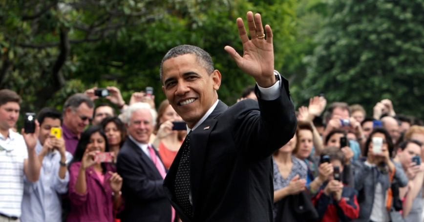 U.S. President Barack Obama waves as he walks on the South Lawn of the White House upon his return to Washington May 2, 2012 after a trip to Afghanistan