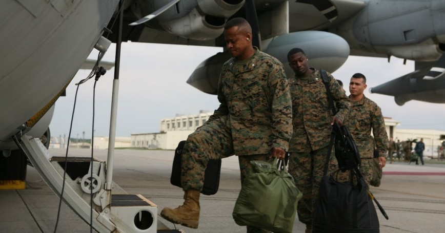 Marines board aircraft in preparation to support Operation Tomodachi
