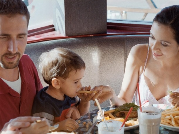 A family eating fries at a restaurant