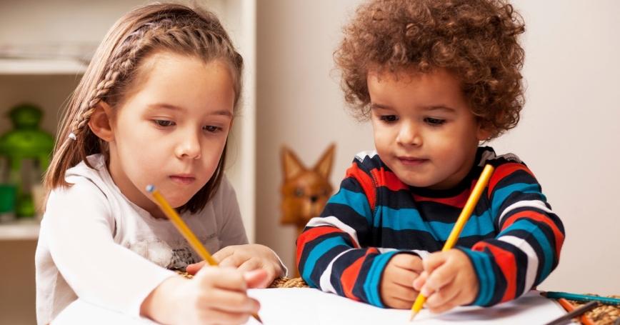 Preschool children drawing with pencils