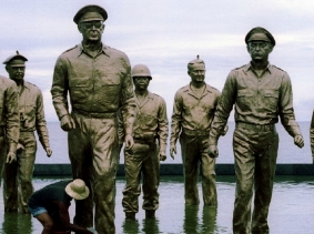 A Filipino worker cleans the statue of late U.S. General Douglas MacArthur October 7, 1994 for the celebration of the 50th anniversary of the landing of U.S. and allied troops on Leyte island in the Japanese-occupied Philippines during World War II