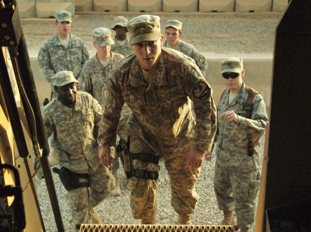 A captain briefs a group of quick reaction force airmen while they board a mine resistant ambush protected vehicle as part of a combat-stress therapy scenario at Joint Base Balad, Iraq, August 20, 2009