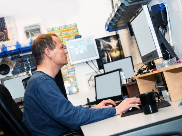 A hacker at his computer desk