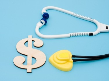dollar sign and stethoscope depicting health care costs