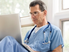 physician with laptop