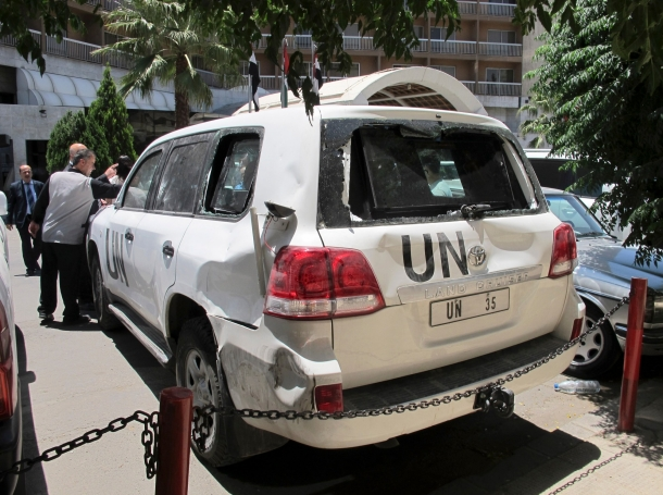 A U.N. vehicle damaged by an angry crowd in al-Haffeh, Damascus, June 13, 2012