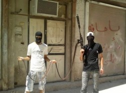 Syrian rebel fighters pose for a picture in Hama, Syria, July 20, 2012