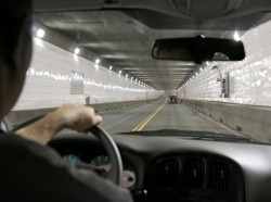A man driving in a tunnel