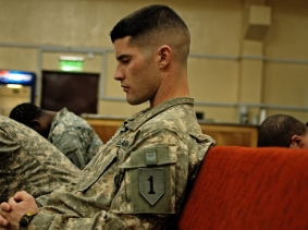 U.S. soldier at a prayer service while on duty in Iraq