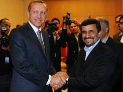 Iran's President Mahmoud Ahmadinejad shakes hands with Turkey's Prime Minister Recep Tayyip Erdogan in Istanbul May 9, 2011