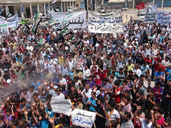 Demonstrators protest against Syria's President Bashar Al-Assad at Binsh near Idlib, Syria, July 27, 2012