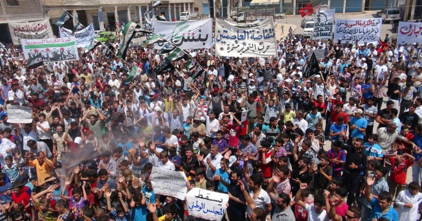Demonstrators protest against Syria's President Bashar Al-Assad at Binsh near Idlib, Syria, July 27, 2012