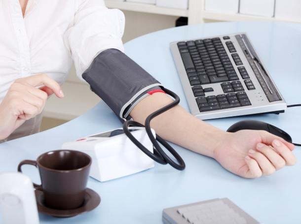 checking blood pressure at work