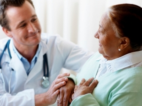 a geriatrician with a patient in a hospital