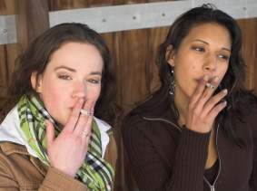 two young women smoking