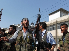 Free Syrian Army members shout Islamic slogans as they prepare to move into Aleppo's district of Salah Edinne August 9, 2012