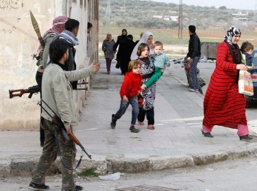 Syrian civilians flee from fighting after Syrian army tanks entered the northwestern city of Idlib