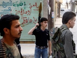 A Free Syrian Army fighter holds an RPG launcher during clashes with the Syrian Army in central Aleppo, August 5, 2012