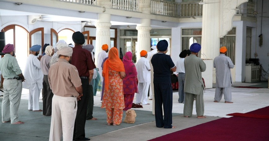 People praying in a Sikh temple
