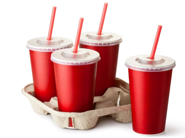 Four red takeout cups with a cup holder, cup, red, soda, cola, four, disposable, paper, drink, straw, lid, beverage, container, cardboard, fizzy, takeout, isolated on white, isolated, white, closeup, fastfood, fast food, fast-food, cup holder, cupholder, takeaway, take-out, take out food, take out, take away, single use, pop, soft, food, plastic, cold, non-alcoholic, recycle, equipment, unhealthy, cafe, liquid, carbonated, brew, single-use, sweet, tea, water, refreshment, cap